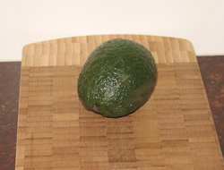 An avocado: an unsweet fruit